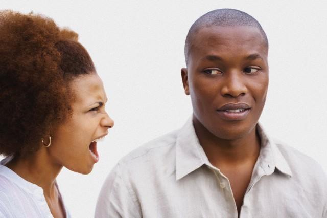 Upset young woman shouting at a man