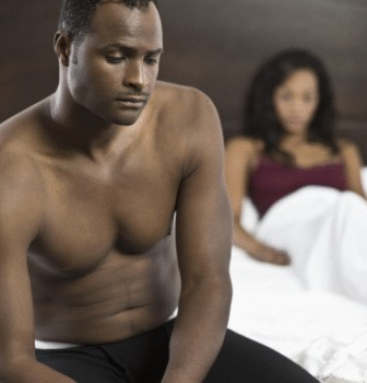 black-couple-in-bed-upset
