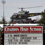 An Ohio State highway patrol helicopter prepares to leave the grounds of Chardon High School in Chardon