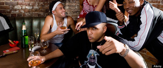 Group of young men and women in hip-hop fashion partying