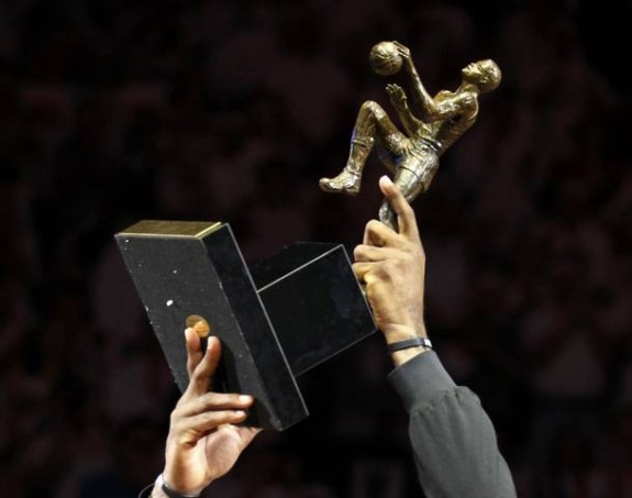 Miami Heat's LeBron James holds the NBA's MVP trophy before Game 1 of their NBA Eastern Conference second round basketball playoff series against the Indiana Pacers in Miami