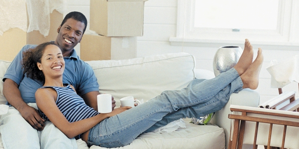 couple-laying-on-couch-with-boxes-in-background