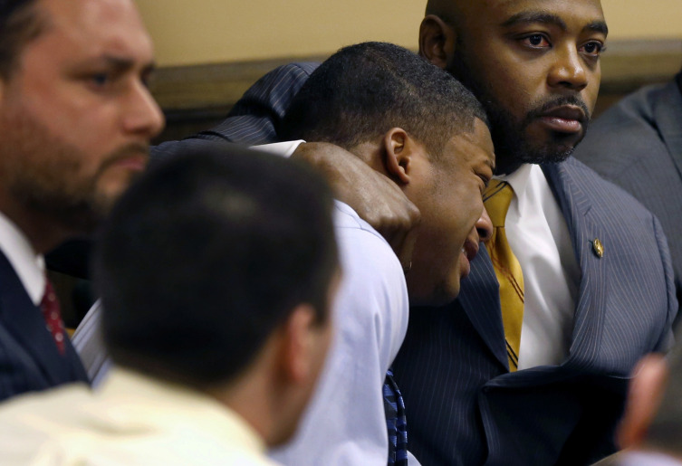 Defense attorney Madison comforts Richmond as Richmond reacts to the verdict during his trial at the juvenile court in Steubenville, Ohio.