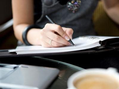 business-woman-writing-at-desk