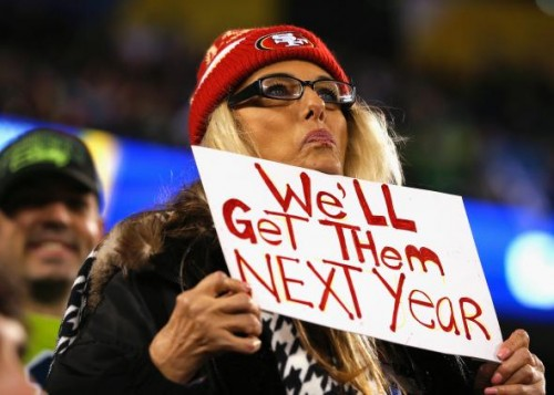 466652925-fan-wearing-a-san-francisco-49ers-hat-holds-up-a-sign.jpg.CROP.promo-mediumlarge